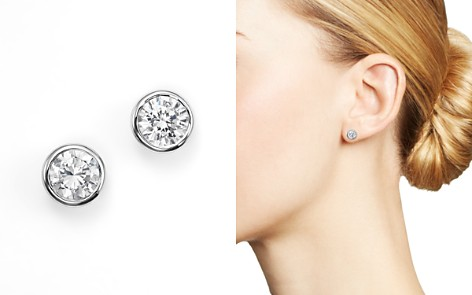 bezel set w union white gold diamond stud earrings