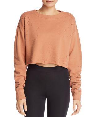 ALO YOGA Fierce Distressed Crewneck Cropped Pullover Sweatshirt in Orange