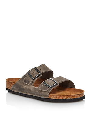 These iconic Arizona sandals by Birkenstock feature thick yet supple leather for breathability and comfort. A foam layer beneath the cork of the footbed provides a high degree of rebound capacity which permits long-lasting cushioning, on a flexible, lightweight, durable, and shock-absorbing Eva sole.