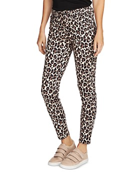 VINCE CAMUTO - Leopard-Print Skinny Jeans in Rich Black