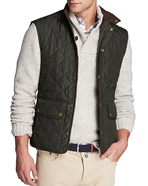 A handsome quilted vest makes an excellent companion on those in-between days, when the weather gets fickle but you want to maintain a poised appearance.