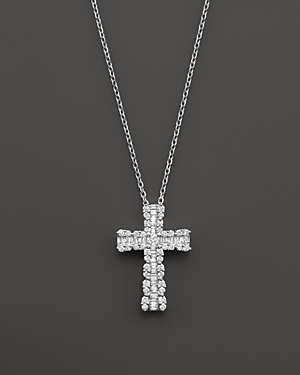 Click here for Diamond and Baguette Cross Pendant Necklace in 14K... prices
