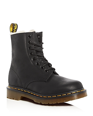 Dr. Martens iconic combat boots hit a stride with the season\\\'s resurgence of \\\'90s-inspired style, updated with cozy faux fur lining for extra warmth as the chill sets in for the season.