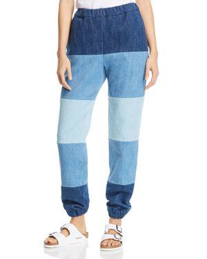 KSENIA SCHNAIDER Patchwork Denim Jogger Pants in Mixed Blue