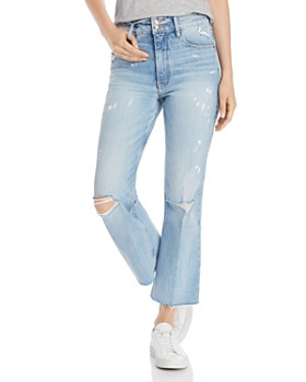 FRAME - Heritage Sylvie Kick Boot Raw-Edge Jeans in Stunt