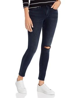 FRAME - Le Skinny De Jeanne Distressed Jeans in Dynamite