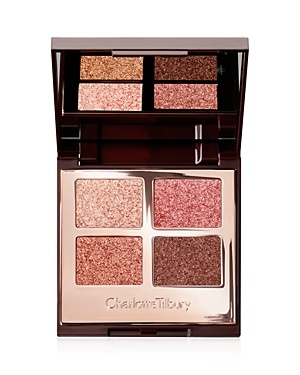 What It Is: In a magical, limited-edition night sapphire starburst case, Charlotte Tilbury\\\'s Luxury Palette of Pops in Celestial Eyes features four color-coded, eye-gilding shades that glimmer with translucent sparkle to make your eyes pop, creating an otherworldly look. From eye-enhancing glittering rose gold to eye-illuminating shimmering taupe, prepare to mesmerize this holiday. Key Ingredients: - Pearl Pigments: with a brilliant, mirror-like reflection, they give your eyes a magical, molten,