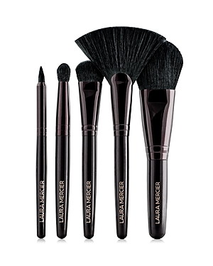 What It Is: A limited-edition collection of five travel-friendly brushes enclosed in a luxurious leather clutch. Set Includes: - Fan Powder Brush - Cheek Color Brush - Smoke Eye Liner Brush - All Over Eye Color Brush - Eye Crease Brush - Leather Clutch What It Does: Expert artisty for eyes and cheeks begins with precision-perfect tools for sculpting, highlighting, contouring and defining. A luxurious set for creating compelling looks on the go, these five travel brushes are housed in a supple pi