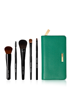 What It Is: An essential selection of five best-in-class brushes for beginning-to-end makeup application. They slip out of a luxe carrying case, ready to go and gift in a limited-edition box wrapped in wintry watercolors by artist Cecilia Carlstedt. Set Includes: - Travel Size Full Coverage Face Brush - Travel Size Blush Brush - Travel Size Eye Shadow Brush - Travel Size Brow Groomer - Travel Size Ultra Fine Eye Liner Brush - Brush Case What It Does: Ultra-soft on skin and designed with polished