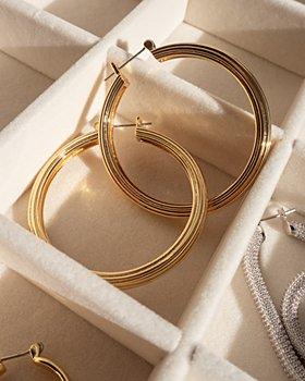 Luv Aj - Cher Extra Large Ridged Hoop Earrings in Gold Tone