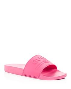 Gucci - Men's Embossed Logo Slide Sandals