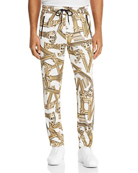 11550c2fa16 TRIPLE POINTS FOR LOYALLISTS IN MEN S. Versace Jeans - Column-Print Track  Pants ...