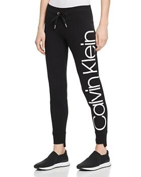 60be901734200 Calvin Klein - Step-Hem Logo Sweatpants ...