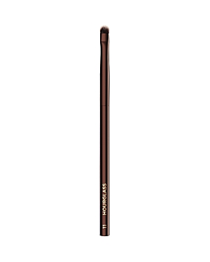 What It Is: The Hourglass No. 11 Smudge brush has short, dense bristles to blend liner or dark shadows for a sultry look. What It Does: - Features Peta-approved, high-grade, ultra-soft Taklon bristles - Weighted metal handle provides control for effortless blending and application - May be used to apply liquid, cream or powder products - Taklon is an excellent alternative for those who suffer from allergies to animal hair - Taklon is a more hygienic alternative to animal hair - Vegan How To Use