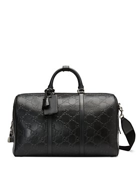 Gucci - GG Embossed Leather Duffel Bag