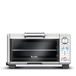 The Mini Smart Oven features 8 preset functions that simplify everything from toasting, broiling, baking, roasting, cookies and reheating. Toasts up to 4 slices of bread and accommodates up to an 11 pizza. Element Iq automatically adjusts heat and calculates cooking times. \\\'A Bit More\\\' button adds additional time without the need to reset the cooking time. The easy to read Lcd display changes color to let you know when the oven is heating. Pull-out crumb tray can be removed from the front for ea