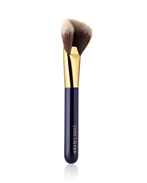 What It Is: A sculpted brush for powder, blush and bronzer. What It Does: Define the look of your face with this specially designed powder brush. The large, sculpted shape precisely sweeps over contours and angles for all-over application or targeted contouring and highlighting. Perfect for loose, pressed, highlighting or bronzing powder. Designed with direction from our top makeup artist. Manufactured and precision-trimmed with meticulous care. Wooden handles are short and lightweight, allowing