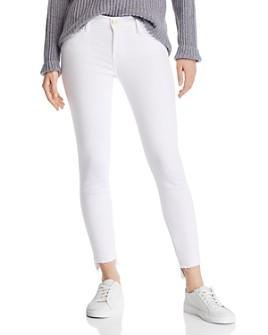 FRAME - Le Skinny De Jeanne Step-Hem Jeans in Blanc
