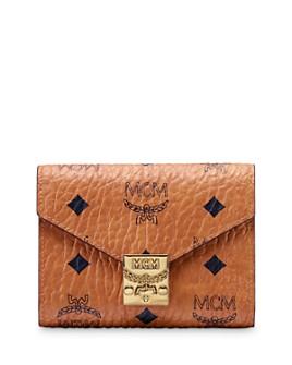 MCM Mina Bow Charm Flap Wallet Medium Pink Blush in rose
