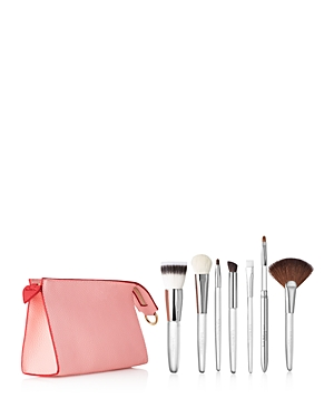 What It Is: A seven-piece brush set that features best-selling full-size brushes for eyes, face and lips. The set was designed to marry with the Power of Makeup Carpe Love Volume Ii set or to serve any makeup wardrobe. It is housed inside a limited-edition coral pebbled vegan leather brush pouch. Set Includes: - Brush 23 Petite Angled Crease Contour to perfectly place and blend eye shadow onto the lid or crease. - Brush 99 Tight Eye Lining to reach between lashes for the coveted tight-lining loo