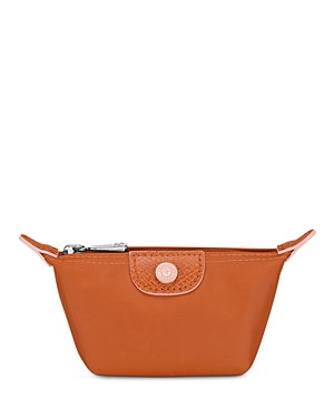 Prepare to swoon over this sweet Longchamp coin case, a pint-sized take on the label\\\'s iconic nylon and leather Le Pliage tote.