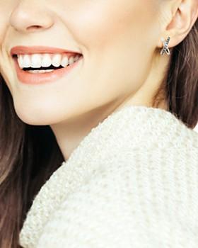 ADORE - Baguette & Pavé Crystal Crossing Stud Earrings