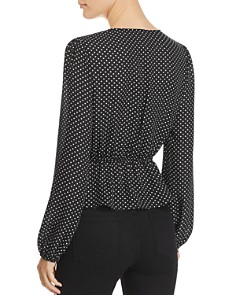 Sadie & Sage - Polka Dot V-Neck Peplum Top