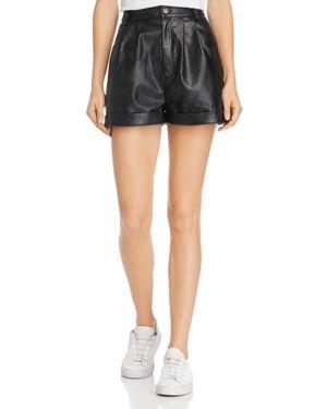 DIVINE HÉRITAGE Faux-Leather Shorts in Black
