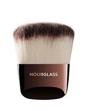 What It Is: The Hourglass Ambient Powder Brush is ideal for evenly dispersing Ambient Lighting Powder all over the face. What It Does: - Features Peta-approved, high-grade, ultra-soft Taklon bristles - Weighted metal handles provide control for effortless blending and application - May be used to apply liquid, cream or powder products - Taklon is an excellent alternative for those who suffer from allergies to animal hair - Taklon is a more hygienic alternative to animal hair
