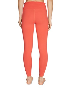Betsey Johnson - High-Rise Smocked Leggings