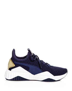 PUMA - Women's Defy Varsity Knit Lace Up Sneakers