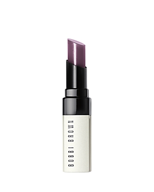 What It Is: Lightweight, sheer and ultra-moisturizing, Bobbi Brown\\\'s Extra Lip Tint has all the benefits of your go-to balm, plus a just-bitten pink stain that brings out the best in lips. What It Does: The subtle stain blends in with your natural lip color, so it\\\'s instantly your perfect shade (and everyone else\\\'s, too). Extra Lip Tint smoothes, softens and comforts lips instantly and over time. You\\\'ll see fewer fine lines, fuller lips and zero flakes. While the rich formula is working its magi