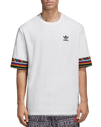 Contagioso capturar Seminario  adidas Originals x Pharrell Williams Solar HU Trefoil Tee ...
