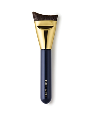 What It Is: A foundation brush ergonomically designed for ultimate definition. What It Does: A worldwide first created exclusively for Estee Lauder, this unique brush provides the ultimate definition. Ergonomically designed, it intuitively follows the contours of your face for precision definition, seamless application and blending. Designed with direction from top makeup artists around the globe. Manufactured and precision-trimmed with meticulous care. Wooden handles are short and lightweight,