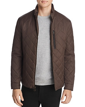 Diamond quilting and water-resistant nylon keep the weather out while exuding sleek modern style in this essential jacket from Cole Haan.