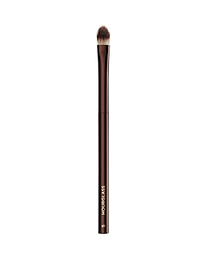 What It Is: The Hourglass No. 5 Concealer brush\\\'s slim, tapered design provides excellent control for detailed concealer application. What It Does: - Features Peta-approved, high-grade, ultra-soft Taklon bristles - Weighted metal handle provides control for effortless blending and application - May be used to apply liquid, cream or powder products - Taklon is an excellent alternative for those who suffer from allergies to animal hair - Taklon is a more hygienic alternative to animal hair - Vegan