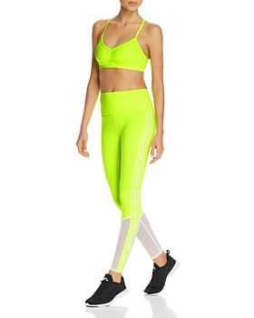 9ca62241f088e8 Alo Yoga - Sunny Strappy Sports Bra & Trainer Mesh-Inset Leggings