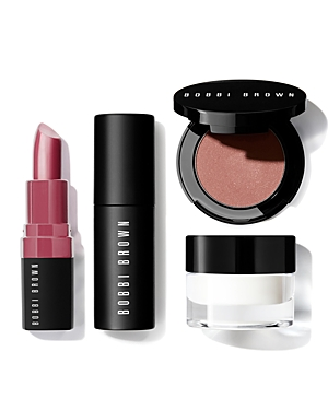What It Is: A travel-ready set of four Bobbi Brown favorites for face, eyes and lips, including our primer-plus-moisturizer, matte bronzer, high-impact mascara and balm-like lipstick. Set Includes: - Vitamin Enriched Face Base, deluxe sample - Bronzing Powder in Golden Light, deluxe sample - Eye Opening Mascara, deluxe sample - Crushed Lip Color in Lilac, deluxe sample How To Use It: Apply Vitamin Enriched Face Base to hydrate and prime skin for smooth makeup application. Use the Bronzer Brush (