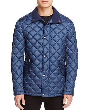 Head out in this lightweight yet warm quilted jacket by Cole Haan.