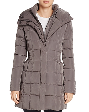 Cole Haan\\\'s chill-chasing puffer is styled with a hood for extra coverage and smocked side waist for a shape-enhancing element.