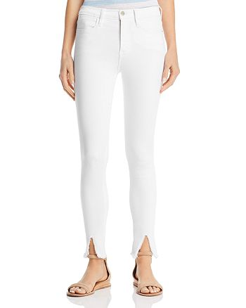 e7630a31c81ec FRAME Le High Raw-Edge Front Split Skinny Jeans in Blanc ...