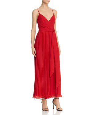 FAME AND PARTNERS | Fame and Partners Pleated Cross-Back Jumpsuit | Goxip