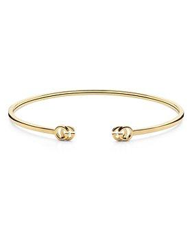 Gucci - 18K Yellow Gold Running Logo Cuff Bangle Bracelet