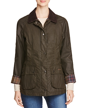 Barbour\\\'s lightweight waxed cotton jacket with cozy tartan lining keeps you warm, dry and impeccably stylish. Extremely durable Thornproof fabric withstands weather, nature and more.