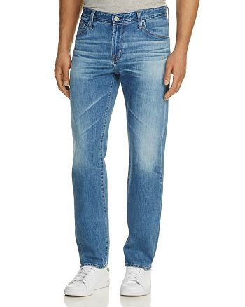 AG - Graduate New Tapered Slim Straight Fit Jeans in Thirteen Years Wind Whipped