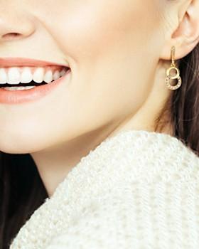 ADORE - Interlocking Pavé Rings Drop Earrings