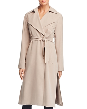 Cole Haan provides sleek coverage with this elongated trench coat. Styled with a waist-cinching tie belt, this neutral-hued design works day or night.