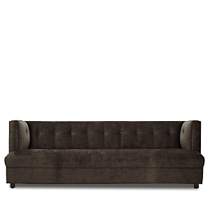 Mitchell Gold + Bob Williams brings a sleek modern update to any room with this streamlined take on a Chesterfield featuring shelter arms and button tufting.
